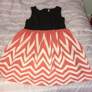 Below the knee pink and white chevron dress